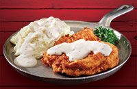 Chicken-Fried Chicken fried just like our chicken-fried steak, but it's with creamy gravy on top and mashed potatoes