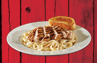 Fettuccine tossed in a rich Alfredo sauce and topped with grilled chicken and Parmesan cheese with garlic bread