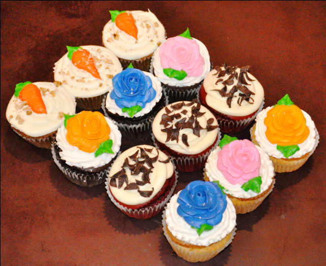 fresh made variety of cupcakes