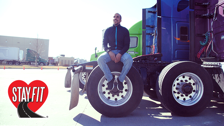 Photo of Siphewe Baleka sitting on tractor tire.