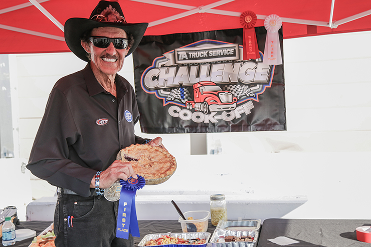 NASCAR legend Richard Petty holding the winning cook-off dish.