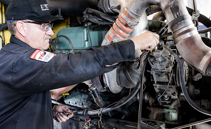 TA Truck Service technician performing commercial truck air conditioning services.