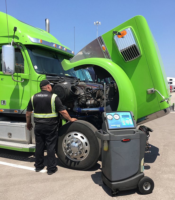 TechOn-SITE technician performing AC services at the Great America Trucking Show.