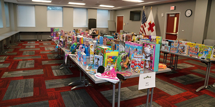 Table filled with toy donations.